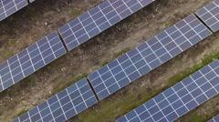 Solar panels aerial rising shot Stock Footage