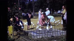 1969: white pigeons are swarming around people who are visiting a memorial  Stock Footage