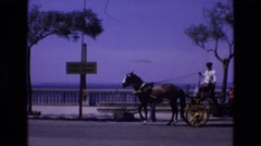 1969: a horse drawn carriage stops on a street SPAIN Stock Footage
