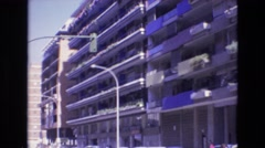 1969: street lights in front of buildings cars driving below SPAIN Stock Footage