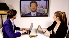 Business people in conference video call with boss in office Stock Footage
