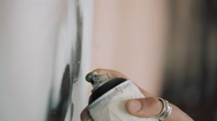 4K Extreme close up the hand of graffiti artist putting detail into artwork Stock Footage