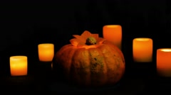 Helloween pumpkin rotation and candles dolly shot Stock Footage