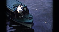1956: the captain of a tugboat stands on the boat as it comes to a stop CUBA Stock Footage