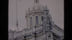 1956: high rise flag fluttering beside a beautiful tourist building CUBA Stock Footage