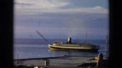 1956: a beautiful cruise liner in the water pulling away from the coast CUBA Stock Footage
