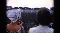 1956: two women on a river tour filming the scenery CUBA Stock Footage