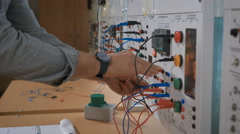 Male technician change parameters of laboratory experiment Stock Footage