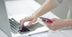 Woman shopping online using laptop computer with payment by credit card Stock Footage