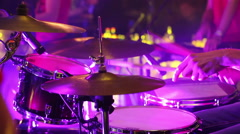 Drummer playing on drum set on stage Stock Footage