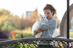 Young lady with Maine Coon cat Stock Photos