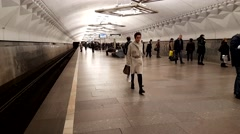 People are waiting for a train at a subway station Stock Footage