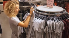 Young Woman Shopping for Clothes In Clothing Shop Arkistovideo