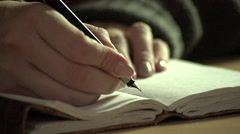 Writing in a journal Stock Footage