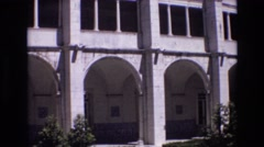 1972: large garden fountain, in a courtyard, surrounded by classic arches  Stock Footage