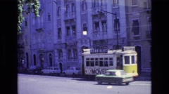 1972: tram moving through the city beside the apartments on either side PORTUGAL Stock Footage