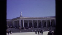 1972: people visiting gathered near old building monument  Stock Footage