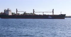 Freighter arriving in Toronto harbor to deliver cargo Stock Footage