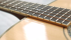 Acoustic guitar sliding close up Stock Footage