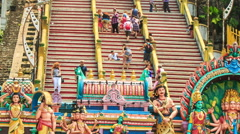 Camera Goes along Steps to Entrance Top of Batu Caves Stock Footage