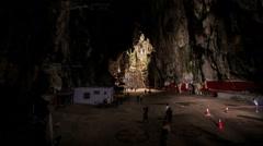 People Walk around Large Square Inside Batu Caves Stock Footage