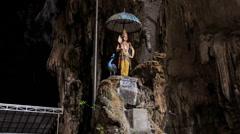 Goddess Under Umbrella Statue Inside Batu Caves Stock Footage