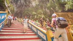 Closeup Tourists Go up Down Steps to Batu Caves Entrance Stock Footage