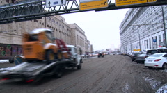 Road Traffic on the City Street. Industrial Buildings, Parking Lot on Both Arkistovideo