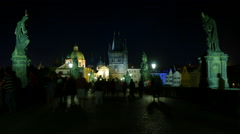 Night timelapse of people in Carles Bridge, Lesser Town Tower and the dome of Stock Footage