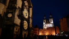 Astronomical clock and Tyn Church at night in Prague, Czech Republic. Stock Footage