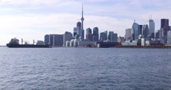 Freighter arriving in Toronto harbor Stock Footage