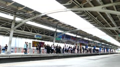 People waiting sky train for transit at Bangkok Stock Footage