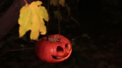 Carved pumpkin hanging on a chain Stock Footage