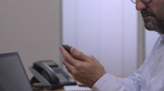 Businessman using smart phone in the office- tracking shot Arkistovideo