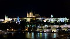 Night timelapse of cruises and Carles Bridge. Prague Castle and Saint Vitus Stock Footage