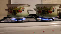Pots are on the fire on the gas stove Stock Footage