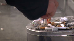 City Culture. Tin Trashcan. Male Pedestrian Pressing Down Cigarette Butt With Stock Footage