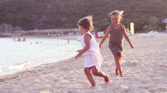 Little girls playing sand beach Stock Footage