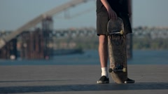 Person holding a skateboard. Stock Footage