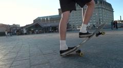 Legs riding a skateboard. Stock Footage