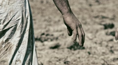 Man and woman hold hands on a background of plowed field. Love. Stock Footage