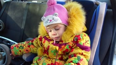 A small child in a child seat in the car. Stock Footage