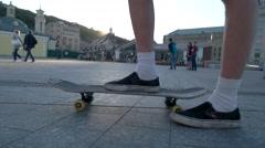 Legs riding on skateboard. Stock Footage