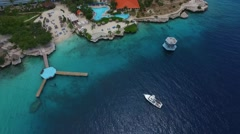 Aerial of boat docking at Hilton Resort Curacao Stock Footage