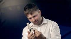Portrait of young man showing much money to the camera Stock Footage