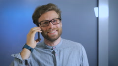 High school student is in college corridor and smiling talking on smartphone Stock Footage