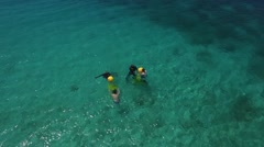 Aerial of people in underwater scooter at Piscadera Bay, Curacao Stock Footage
