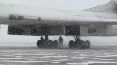 People in the snow under the plane Stock Footage