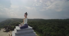 Buddha on top of a mountain Stock Footage