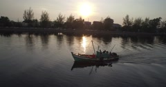 Aerial of asian fishing boat on sunrise Stock Footage